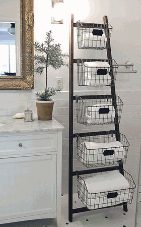 Towel storage. This is $390! Could make something similar. Wooden ladder with wire baskets.