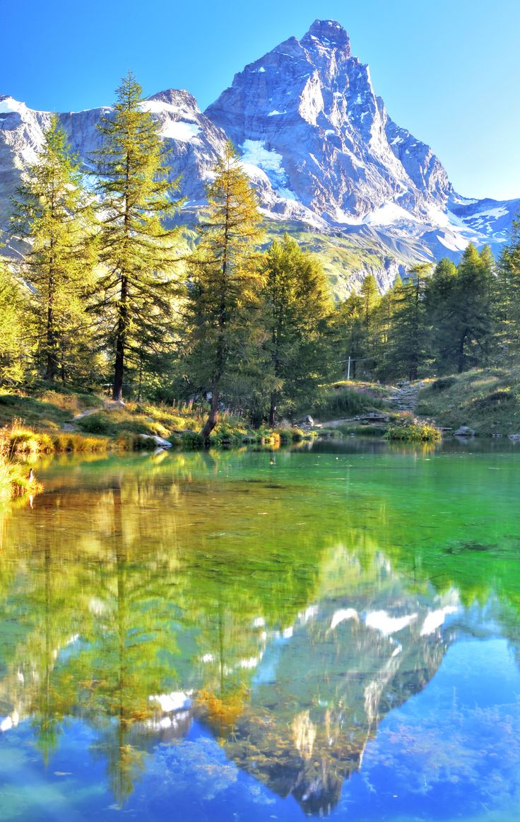 the Matterhorn - the Matterhorn, is reflected on the lake Blue.