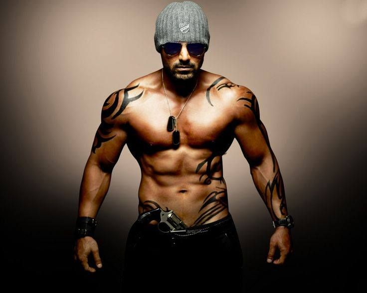 John Abraham has one the best and finest bodies around, that has came up only because of John Abraham's workout routine which is too tough and highly intense. With a height of 6'1'' is John is blessed with extra fine physique and posses an athletic body.