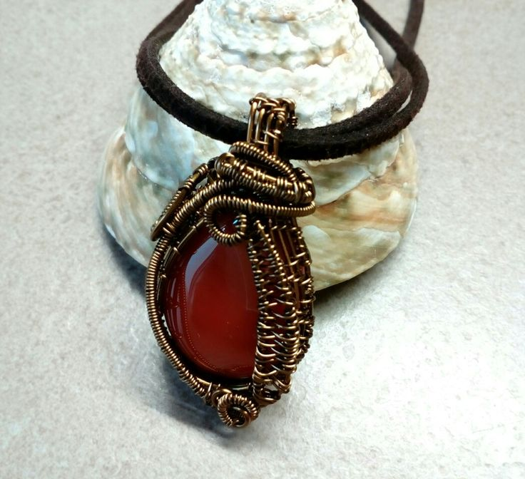 Wire wrapped carneol pendant in vintage bronze with suede cord
