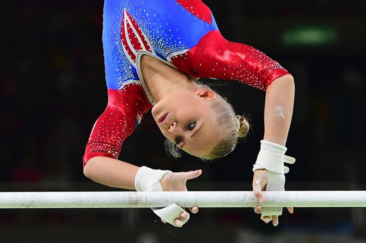 Russia's Daria Spiridonova competes in the qualifying for the women's Uneven Bars event of the Artistic Gymnastics at the Olympic Arena during the Rio 2016 Olympic Games in Rio de Janeiro on August 7, 2016. / AFP / EMMANUEL DUNAND