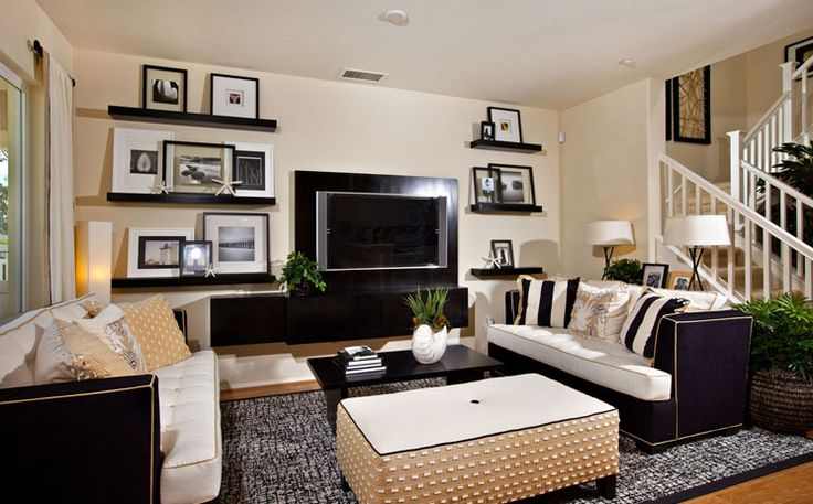 LOVE those shelves around the TV, especially since i cant find a entertainment center to fit our huge tv!
