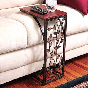 Product # 61813 This handy side table slides neatly up to sofa or chair to provide the perfect flat surface for a beverage, snack or remote control. Beautiful upright table includes a wooden top with dark stain finish, burnished metal sides and intricate leaf metalwork. Bottom panel slips easily underneath sofa. Great for small space, apartment and dorm living.