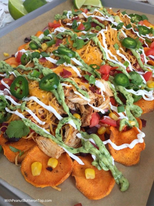 Loaded Sweet Potato Nachos with Homemade Sweet Potato Chips - drizzled in Greek Yogurt Spinach Guacamole and served with Slow Cooker Mexican Style Shredded Chicken - it is the perfect tailgating dish or for a crowd of hungry friends and family. Sure to be raved about!