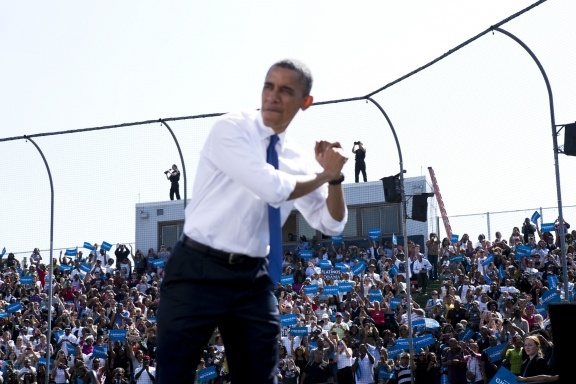 A security detail keeps watch above the crowd as President Barack Obama makes a campaign stop at G. Richard Pfitzner Stadium in Woodbridge, Va., on Sept. 21, 2012.