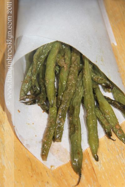 Crunchy Shriveled Green Beans  2 lbs. green beans  olive oil  garlic powder  salt  Method:  Preheat oven to 350 degrees. Rinse green beans and drain on paper towels. Trim the edges with a paring knife. Add beans to a pan and drizzle liberally with oil. Sprinkle generously with garlic powder and add salt, to taste. Bake for 45 minutes-1 hour until shriveled and browned at the edges.