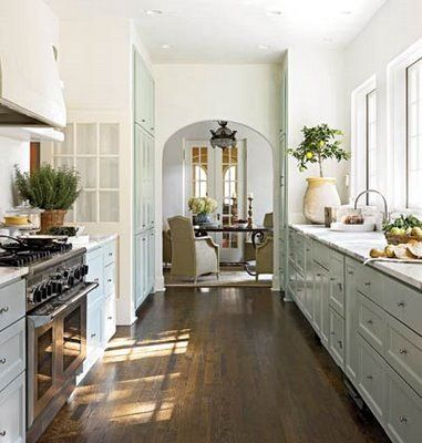 galley + arch + white + wood floor.