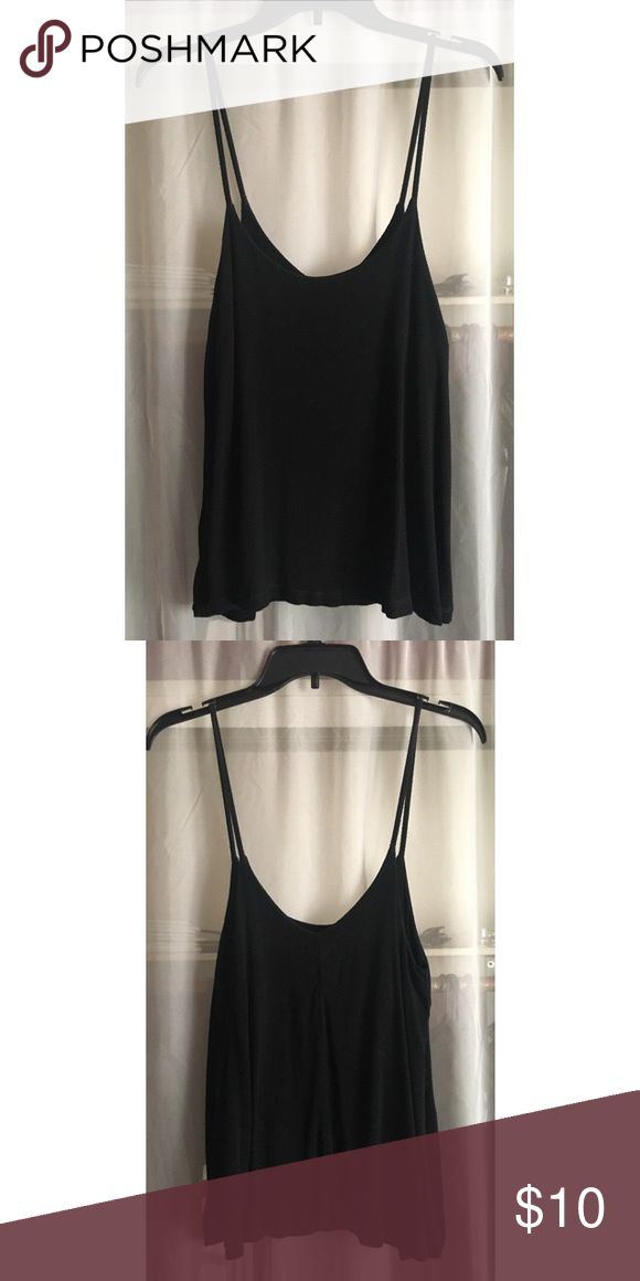 ⚡️Brandy Melville Black Aarika Tank Brandy Melville black Aarika tank. Used condition, has flaws, very faint discoloration on back of straps. Hardly noticeable and nothing long hair or a sweater can fix! Brandy Melville Tops Camisoles