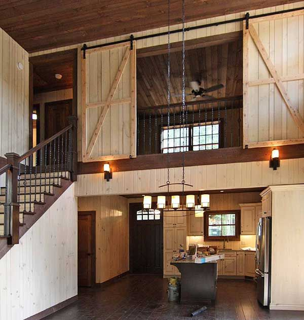 check out the barn doors in the upstairs bedroom that open to the great room in #houseplan 18766CK