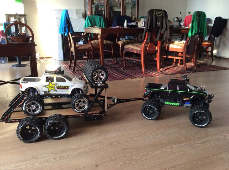 Custom Traxxas Summit w newly designed trailer and custom e Maxx on board..