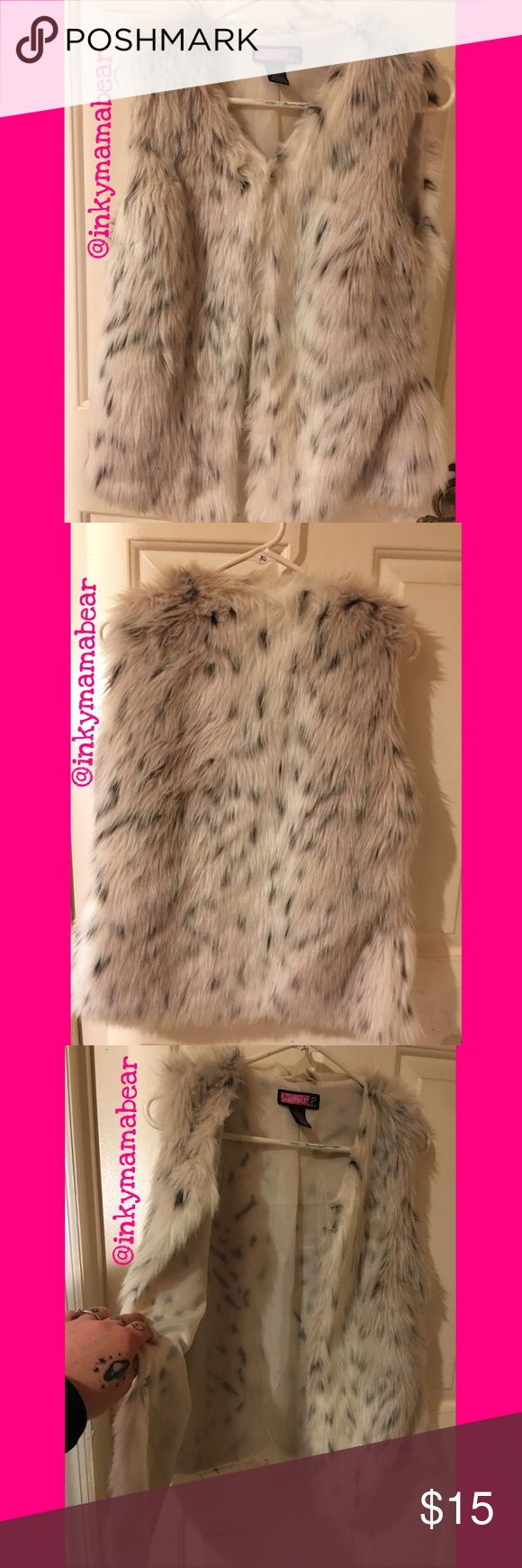 """Super Cute """"Spotted"""" Faux Fur Vest! This """"spotted"""" faux fur vest reminded me of Cruella DeVille, so I just HAD to buy it! Unfortunately, I only wore it a handful of times even though I loved it. The brand is """"Say What?"""" And this is a size Large. Super comfy and very trendy (and VERY soft, it doesn't have that """"plastic-y feel some faux fur things have). Feel free to ask questions🙂 no lowballing...booo😵reasonable offers👌👌 Say What? Jackets & Coats Vests"""