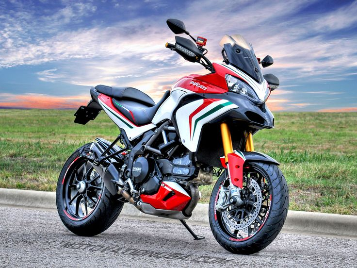 The Motovation custom Ducati Multistrada 1200S Tricolore. Mix equal parts superbike with equal parts motard. Add a dash of touring and a whole lot of torque, and you find yourself with an Italian adventure weapon.
