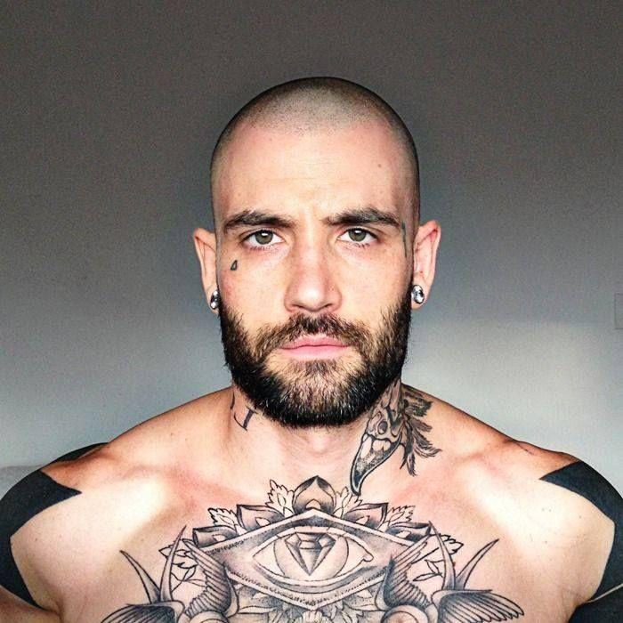 Bald men with tattoos