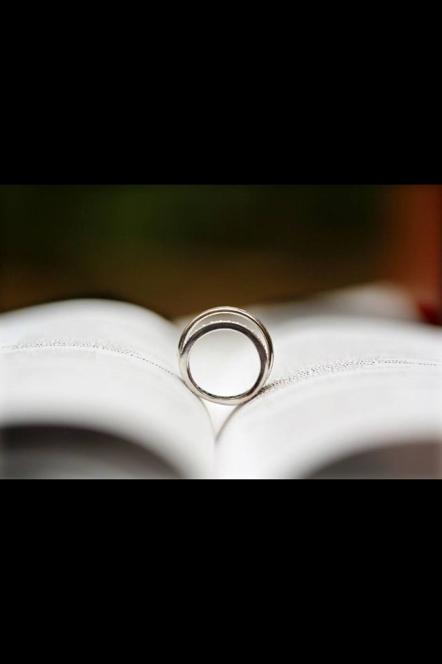 Our wedding bands sitting on top of our bible. Had guests sign our bible and highlight their favorite bible verse.
