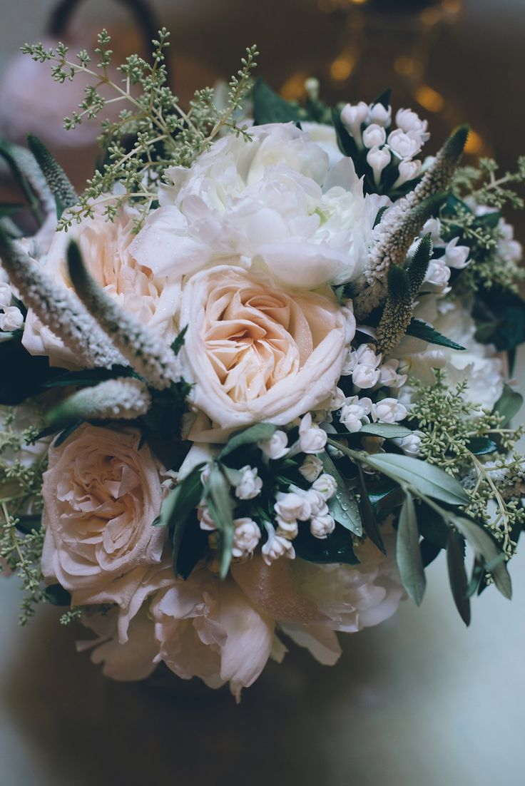 Peach garden roses, white peonies and olive branches in this bouquet are perfect for a Tuscany destination wedding