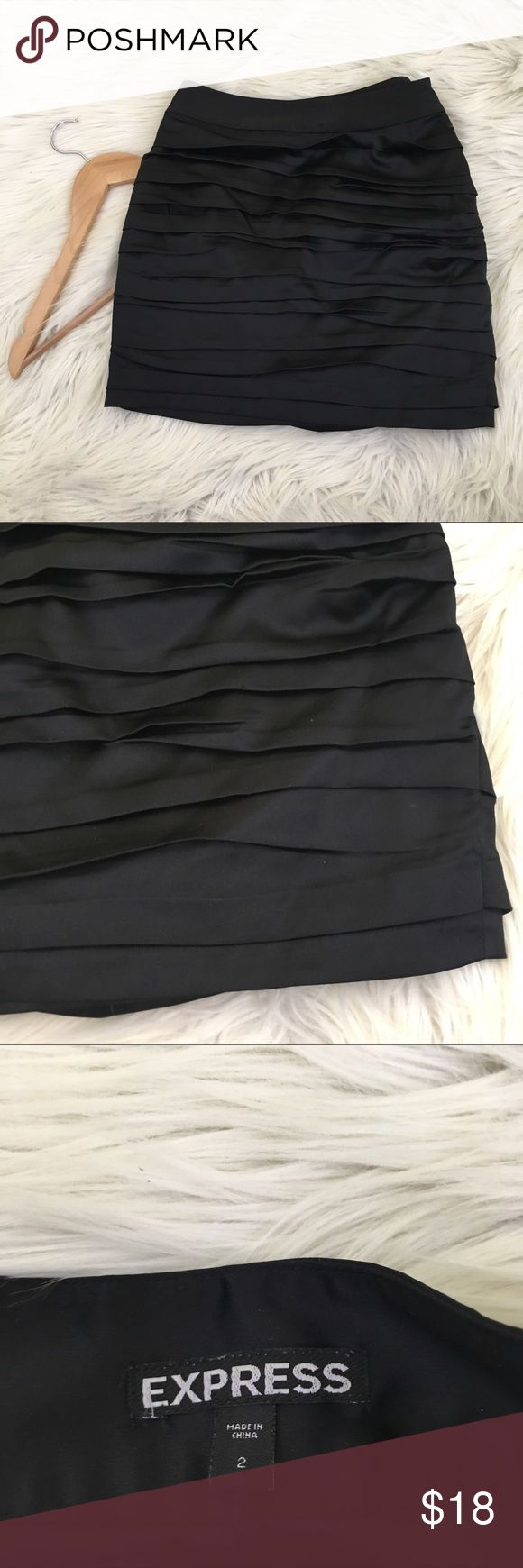 Express Satin Black Ruffle Mini Skirt | Sexy & Fun Express women's size 2 Mini Skirt • black stain • ruffles/Fabric layers • Fitted • excellent condition no flaws  Length: Waist flat:  📌NO lowball offers 📌NO modeling 📌NO trades  Come check out the rest of my closet! I have various brands and ALL different sizes ❤️ Express Skirts Mini