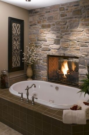 Rustic Master Bathroom with Wall Tiles, Herringbone brick pattern, Bathtub, Two way fireplace, drop in bathtub, Fireplace