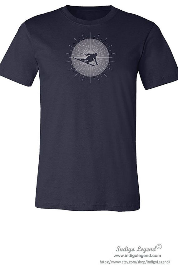 Skier T shirt for men. Skier ski jumper silhouette blue or white printed on ring spun cotton shirt.   PRINTED DESIGN: Check out intricate details of actual print on fabric shown in the close-up fabric photo above. In the printing process the ink bleaches out parts of the black shirt color and replaces the shirt color with a beautiful blue or white design color for a vivid, but soft print. The print is not plastic, thus will never peel or crack—because the design is dyed right into the…