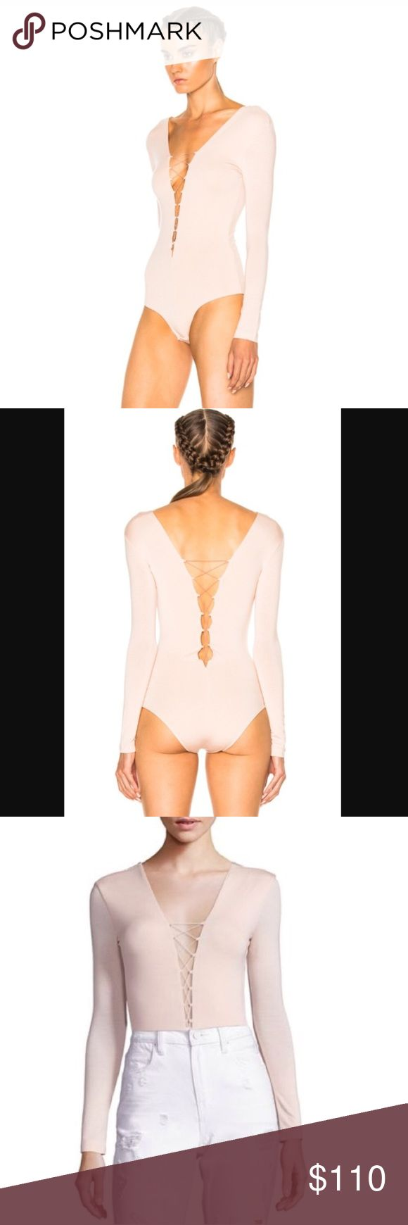 NWTT by ALEXANDER WANG nude blush lace up bodysuit NWT! I bought this in pretty much every color along with the strappy midi dresses that came out this season and this one was final sale so couldn't return it. Flawless and new, selling only because I have too much. Perfect with a pleated skirt or jeans! Dress up or down :). MSRP 160+tax! T by Alexander Wang Tops