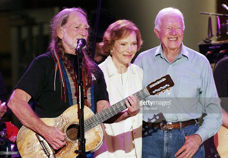 Musician Willie Nelson is joined by former First Lady Rosalynn Carter and former President Jimmy Carter at the taping of 'CMT Homecoming: Jimmy Carter in Plains,' which will premiere on CMT in December 2004.