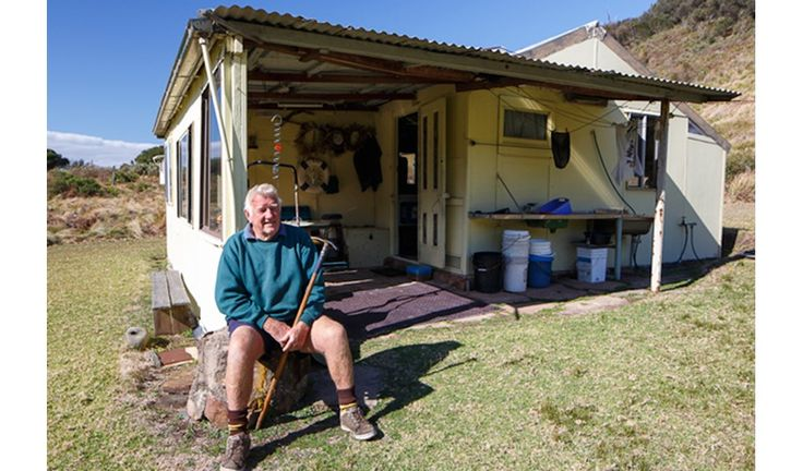 Billy Burn, outside his family's shack at Little Garie Beach, Royal National Park, NSW.