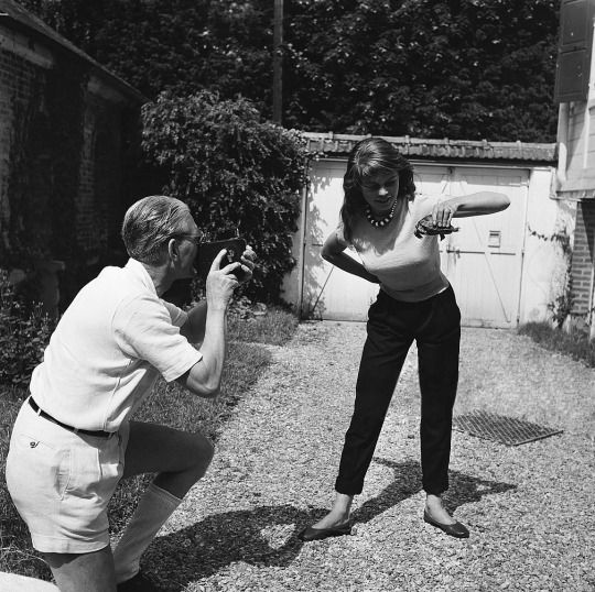 Louis Bardot photographing his daughter, Brigitte and turtle Oscar, in Louveciennes, France. May, 1952