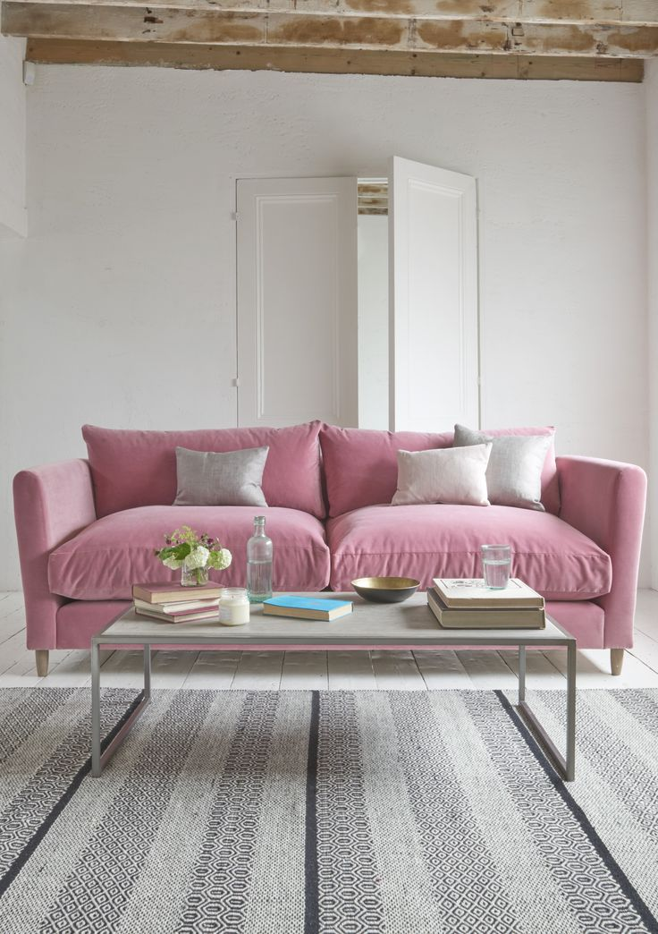 Loaf's comfy Flopster sofa in a deep pink Dusty Rose velvet in this white-washed living room with exposed beams and contemporary coffee table