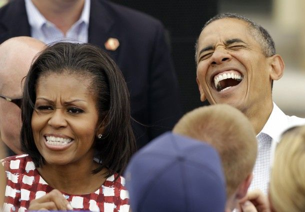 President Barack Obama and first lady Michelle Obama greet supporters during a campaign stop at the Alliant Energy Amphitheater, Wednesday, Aug. 15, 2012, in Dubuque, Iowa. The president is on a three-day campaign bus tour through the state. [AP Photo]