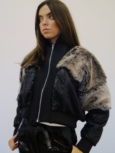 Beautiful black padded jacket with brown faux fur yoke. Edged and lined in black, with extra high neck and silver plated zip. ONE SIZE ONLY.