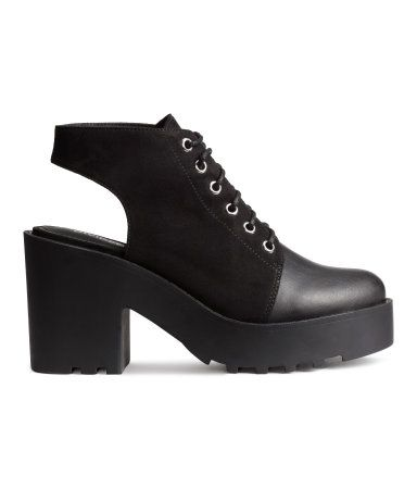 Platform ankle boots in imitation suede with an open heel, imitation leather toe section, and laces. Fabric lining and chunky rubber soles. Front platform height approx. 1 1/4 in., heel height 3 3/4 in.
