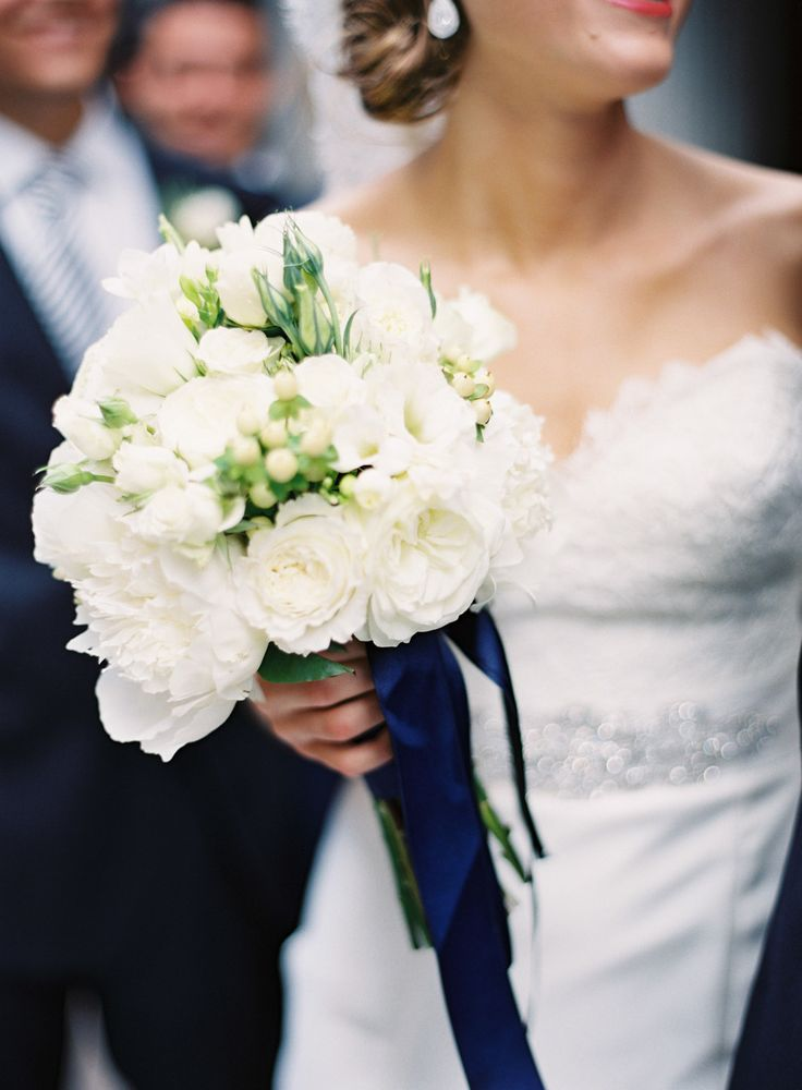 Lovely White Bouquet with just a touch of greenery + blue ribbons | Photography by Brett Heidebrecht | See the wedding on SMP: http://www.StyleMePretty.com/2013/10/11/wiup-oklahoma-city-wedding-from-brett-heidebrecht-winners/