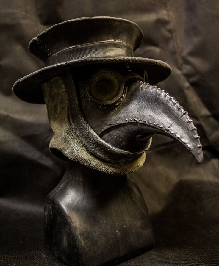 Traditional Plague Doctor Mask with Hat  With the plague doctor masks I like how the eyes are hidden- the opposite of most masks. Again I enjoy the religious/ supernatural connotations.