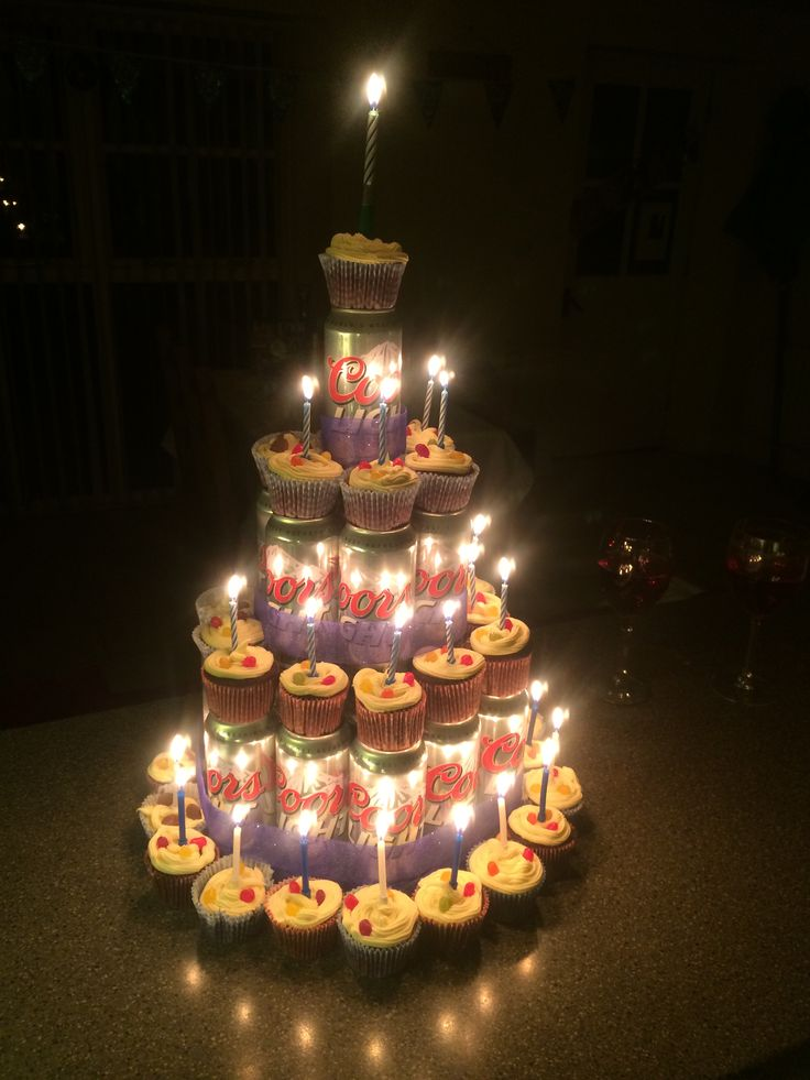 Looks even better when the candles are lit....Pretty chuffed with my cupcake and beer can stack birthday cake surprise! Who knew Coors Light, Devil's Food Chocolate and Red Velvet cupcakes made such a perfect combination?! I could get used to this baking malarkey