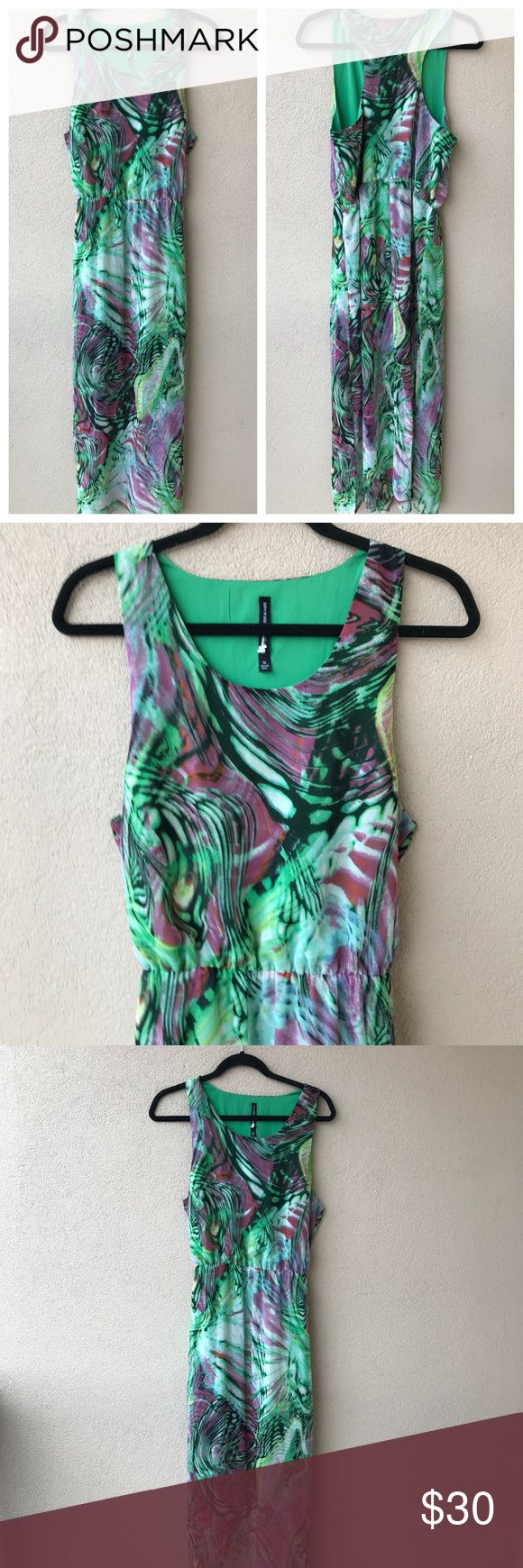 """W118 by Walter Baker Racerback Maxi Dress Watercolor swirl print racerback maxi dress from W118 by Walter Baker.  This green and purple dress has a scoop neck, side slit, blouson bodice and flowy skirt.  Lined up to the thighs.  Excellent used condition.  - Size Medium M - Approx. 18.5"""" armpit to armpit - Approx. 14"""" across waist (elastic waistband) - Approx. 57"""" long - 100% polyester W118 by Walter Baker Dresses Maxi"""