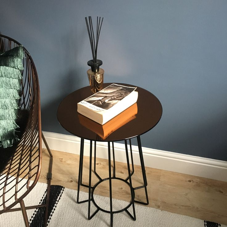 Kathryn's Copper and Black Orbit Table looking great agains those dark walls!