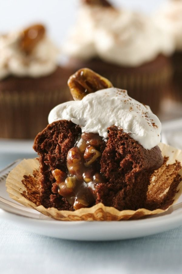 Sometimes you just don't know if you want a chocolate cupcake, or pecan pie! Now you don't have to decide: These hybrid cupcakes combine the best of both worlds—and there's no crust to make! They're topped with a yummy spiced cream that sets up with the help of a little gelatin. Garnish with cinnamon, or with plain or candied pecans (directions in recipe). Fall-themed paper liners would be even more festive!