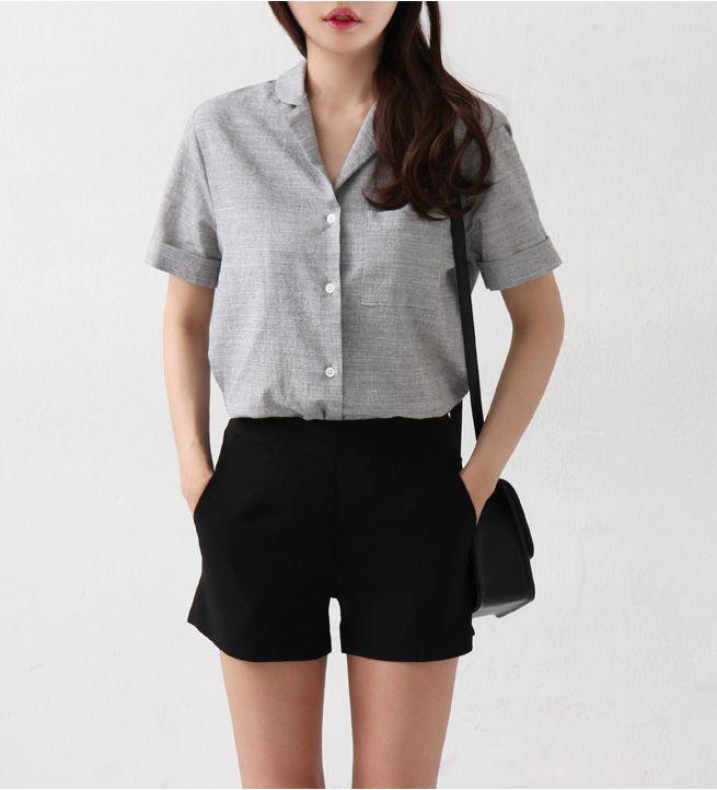 grey button down, black shorts, black bag