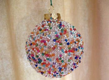 Seed Bead Ball Ornament Craft: Use glass ornament, seed beads and craft glue. Cover glass ornament with craft glue, dip into bowl of seed beads to cover. You can touch up any missed spots with paint brush and glue, adding beads with your finger.