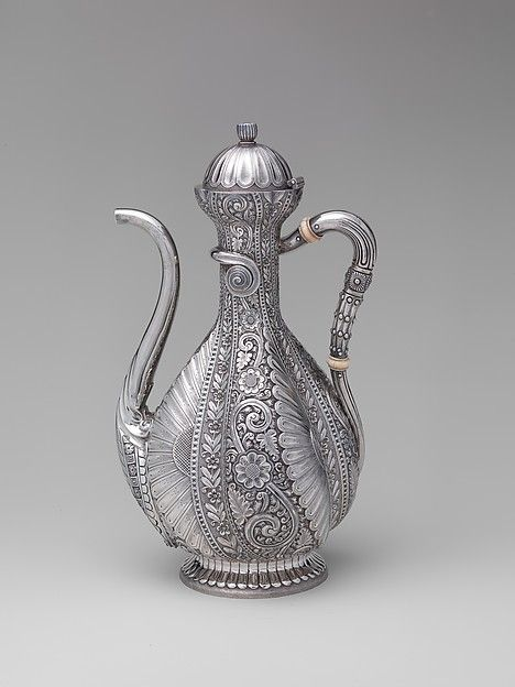 Coffeepot, Gorham Manufacturing Company, 1881.Providence, Rhode Island, USA. Silver and ivory This is a much decorated coffeepot that is characteristically Art and crafts, but can also fit just as well in the Aesthetic style by saying that the beauty of an object needs to serve no purpose. The coffeepot is decorated with plant-like motifs with some details resembling bird feathers. Implying strong influence of Art and crafts.