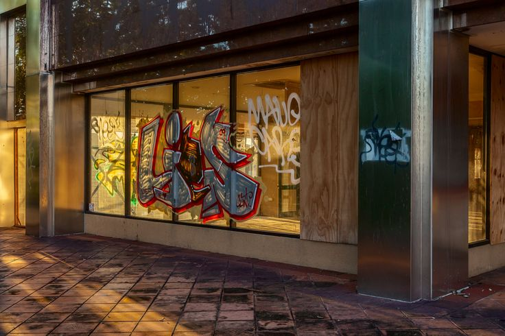 A vacant store with a store front that's been tagged by vandals at sunset on the Gold Coast, Australia.