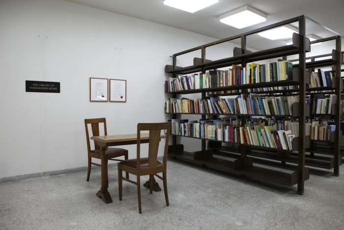 Installation View | A Thousand Doors, The Gennadius Library, Athens, May – June 2014  Meriç Algün Ringborg, The Library of Unborrowed Books. Section V:  The Gennadius Library, ASCS, Athens, 2014  Site-specific installation with books, shelves,  brass sign, two contracts  Courtesy the artist, Galeri NON, Istanbul and  Galerie Nordenhake, Stockholm. © Photographer NataliaTsoukala