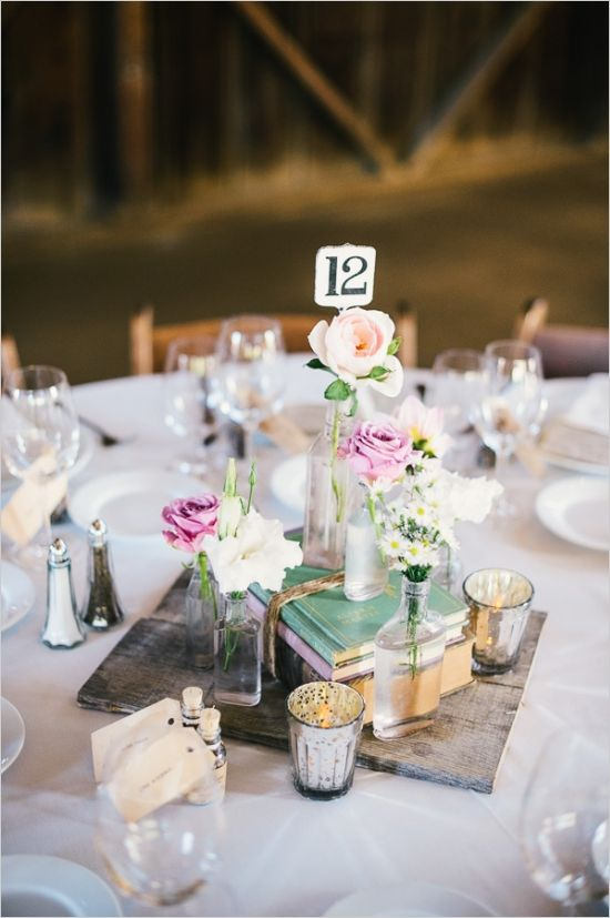 floral pieces and book combination for centerpieces #weddingreception #tabledecor #weddingchicks http://www.weddingchicks.com/2014/03/26/rustic-romance-wedding/