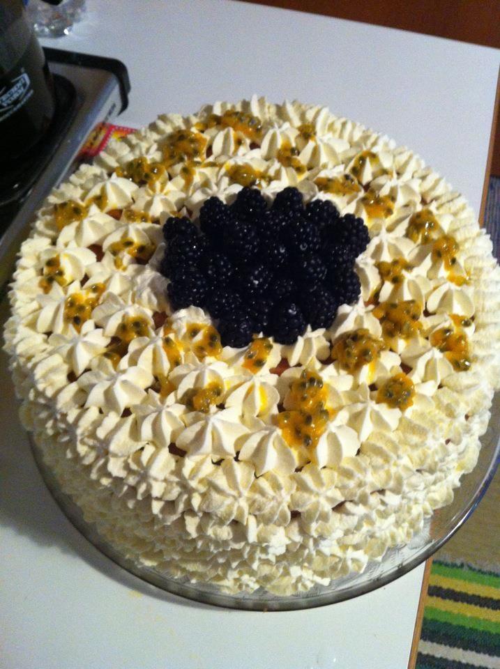Sponge cake w blackberries, vanilla custard, raspberries and blueberries. On the top - cream, blackberries and passion fruit.