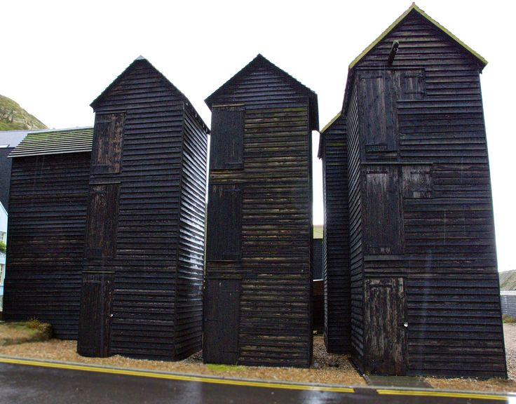 Hastings, England. Fish net huts in the old town. They were built when nets had to be dried to prevent rotting, but nowadays the nets are nylon and can be left out, so the huts are used for other storage. They are tall because of the limited space at the head of this beach in Victorian times when they were built and also to avoid paying excess ground tax.