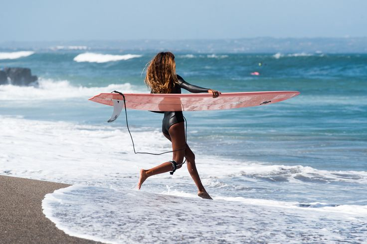 """Sure, Mariah Carey sang: """"All I want for Christmas is you"""".   But she isn't an avid surfer, and didn't know about custom made surfboards.   Our bucket list of the ultimate Christmas gifts for surfer girls."""