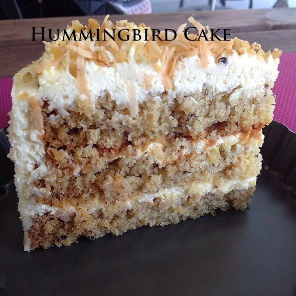 Hummingbird Cake recipe - 3 cups all-purpose flour 2 cups white sugar 1 teaspoon baking soda 1 teaspoon salt 1 teaspoon ground cinnamon 3 eggs- lightly beaten 2 teaspoons vanilla extract 1 1/2 cups oil 1 (8 ounce can) crushed pineapple -do not drain 2 cups bananas, mashed or about 3 – 4 large bananas 1 cups pecans or almonds/ walnuts chopped