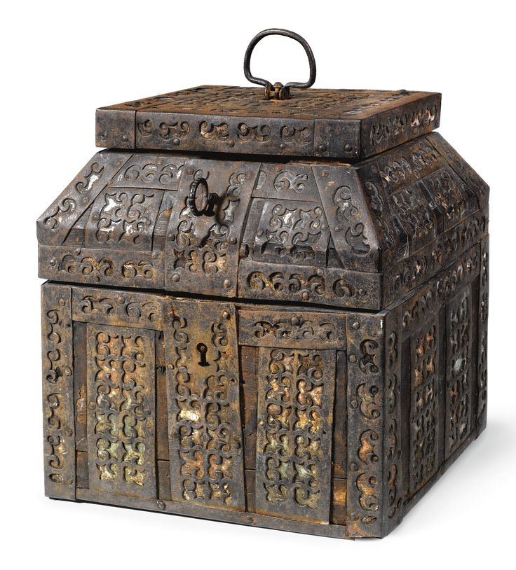 A LARGE WOOD AND METAL CASKET, 18TH CENTURY of teremok form, containing lower and upper compartments, wood carcass overlaid remnants of green and red foil and applied with strapwork, with original key   height: 28cm, 11in.