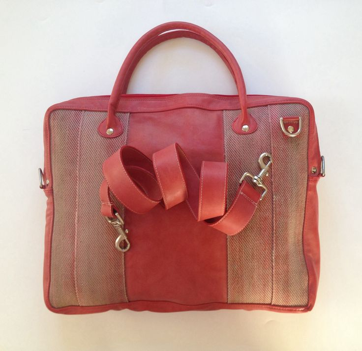 Managersbag, made of used firehose and red leather.
