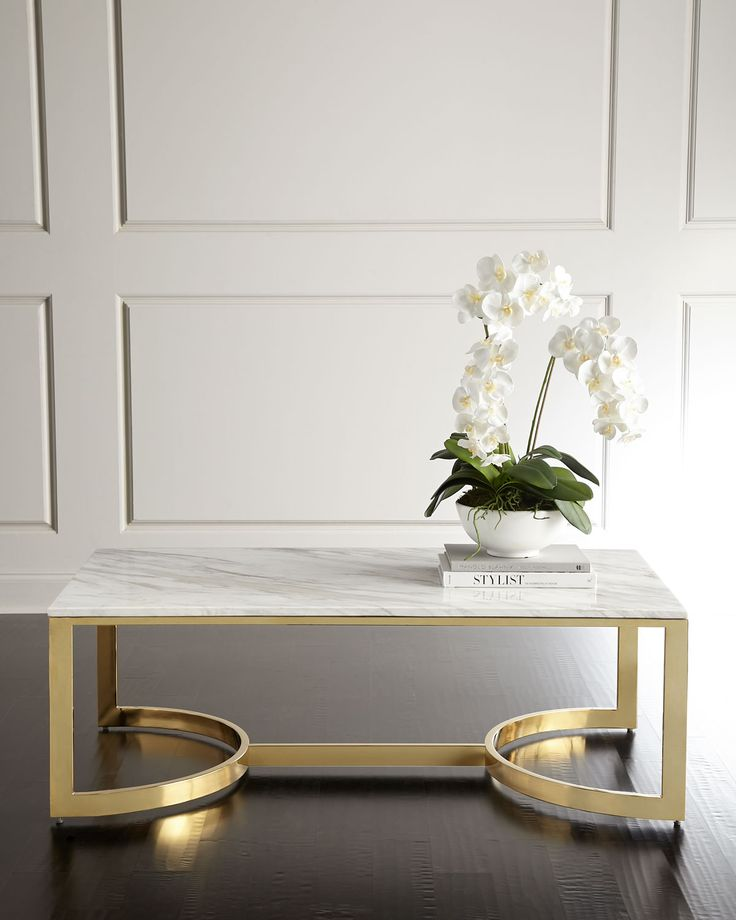 "Handcrafted coffee table. White marble top. Tubular steel base with polished-brass finish. 54""W x 30""D x 18""T. Imported. Boxed weight, approximately 193 lbs."