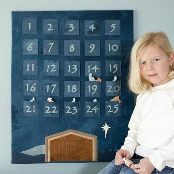 DIY Felt Advent Calendar --   The wool background with the stable and star set the scene for Mary, Joseph, and baby Jesus figures. Free patterns.